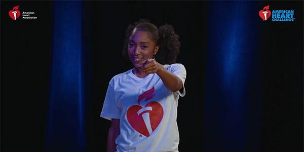 Comfort Fedoke wearing an American Heart Assocation white t-shirt