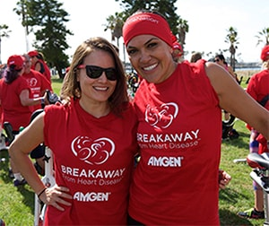 Photo of two women wearing a red event shirts